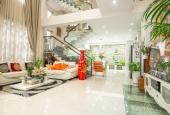 Bán nhà MT Phan Xích Long, dt 4x16m, giá 32 tỷ, 1 Hầm, 4 Lầu.